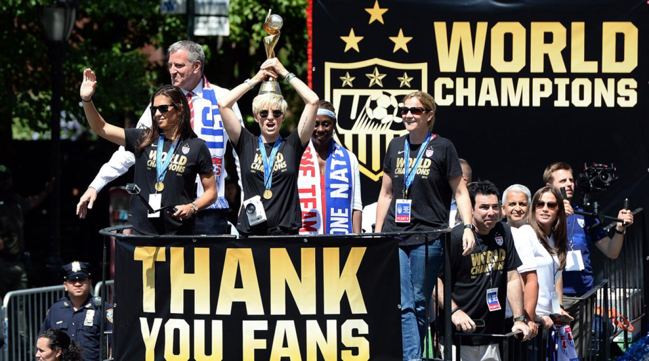 Megan Rapinoe and Carli Lloyd ride a float during the U.S. women's national team's World Cup victory parade in New York City