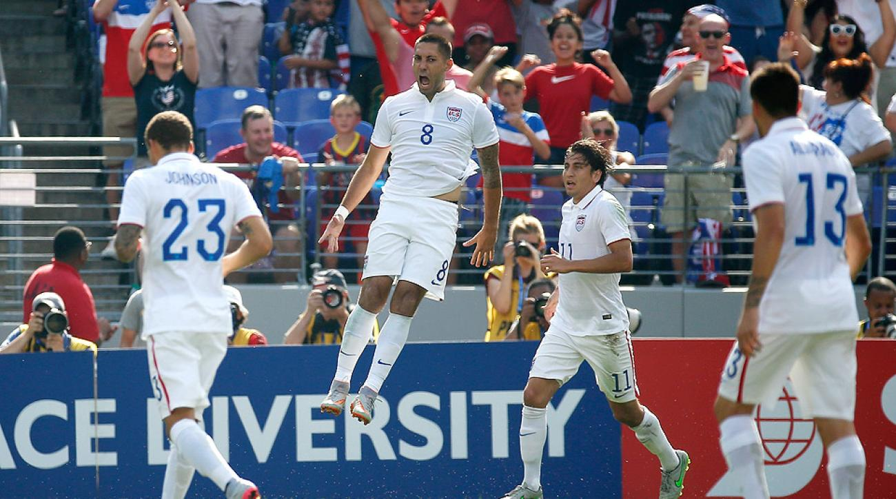 Clint Dempsey scored his first international hat trick as USA advanced to Gold Cup semis in win over Cuba.