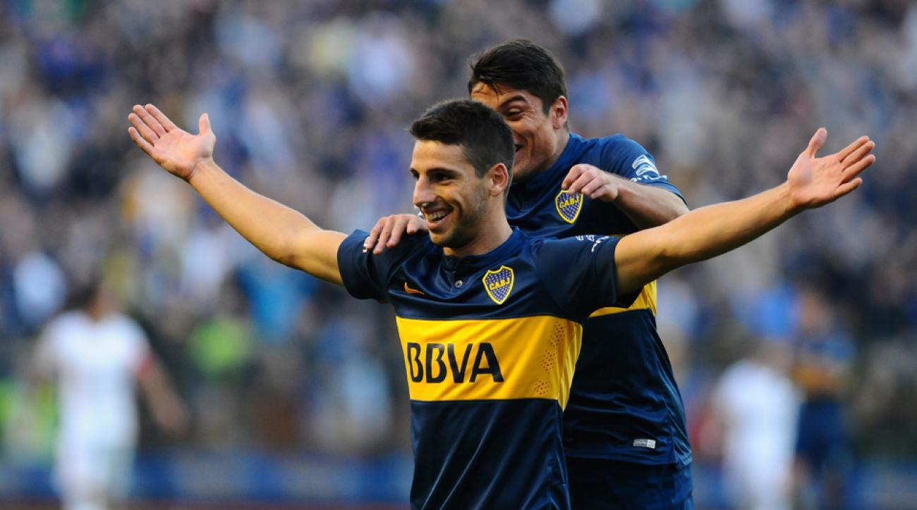 Boca Juniors forward Jonathan Calleri celebrates his rabona goal vs. Quilmes in Argentina