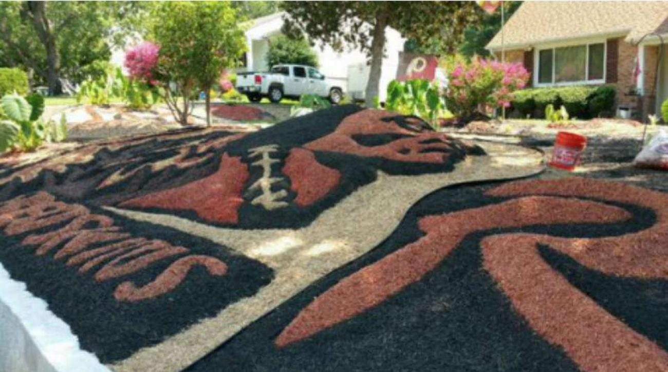 Redskins fan decorates lawn with team logo