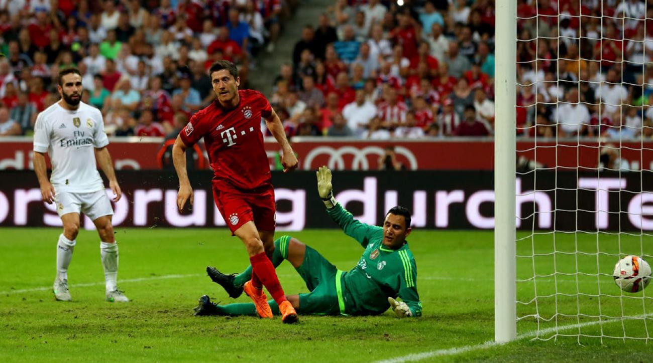 Robert Lewandowski scores the winner for Bayern Munich against Real Madrid in the Audi Cup final