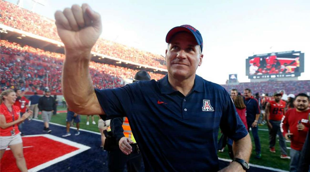 Arizona's Rich Rodriguez hits the whip with the Arizona gymnastics team