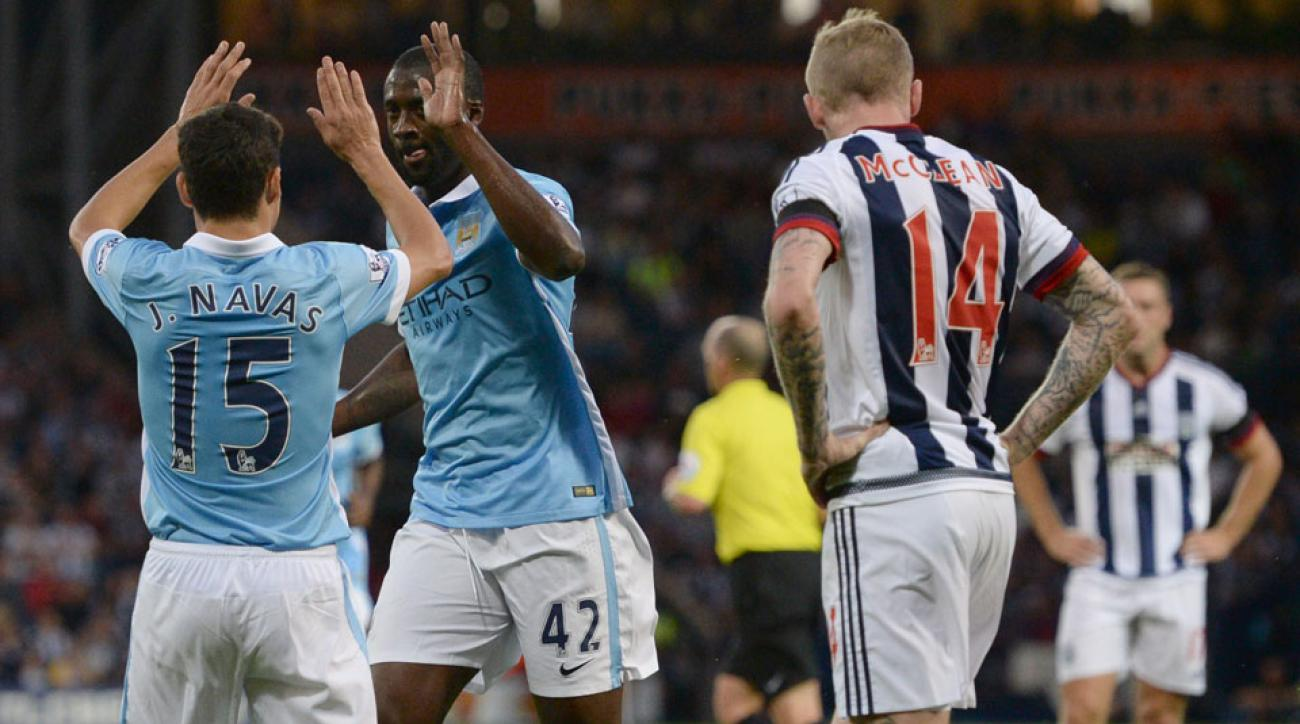 Yaya Toure celebrates a goal for Manchester City against West Brom