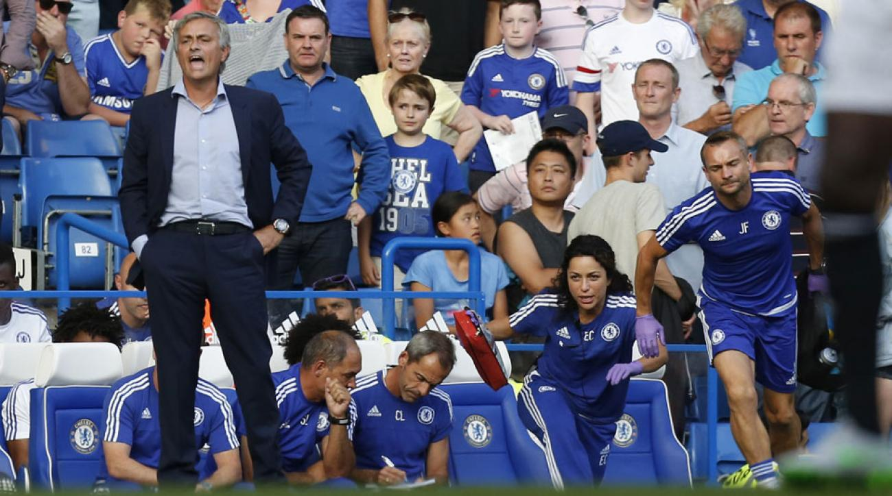Chelsea's Jose Mourinho stands as team doctors Eva Carneiro and Jon Fearn rush out of the dugout to tend to a hurt Eden Hazard