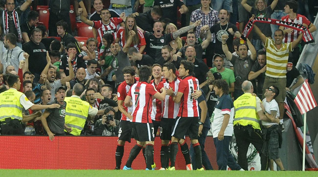 Aritz Aduriz is mobbed by teammates after one of his three goals vs. Barcelona for Athletic Bilbao