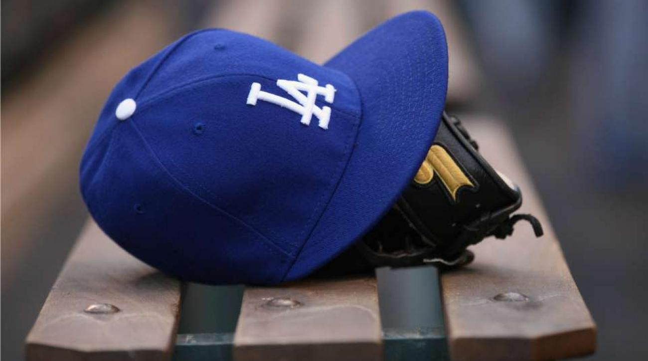 Dodgers ball boy falls over wall