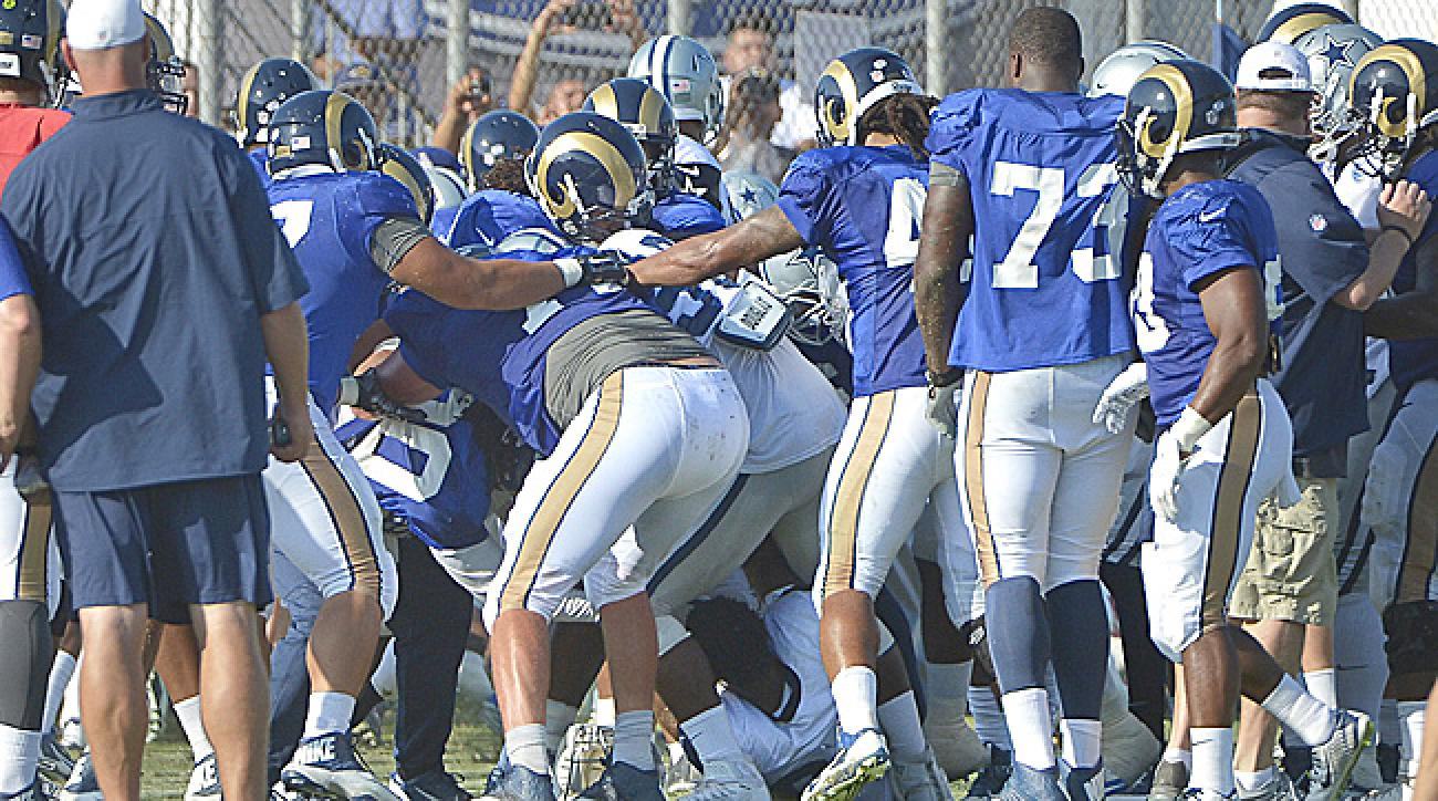 Cowboys and Rams fight at a joint training camp practice.