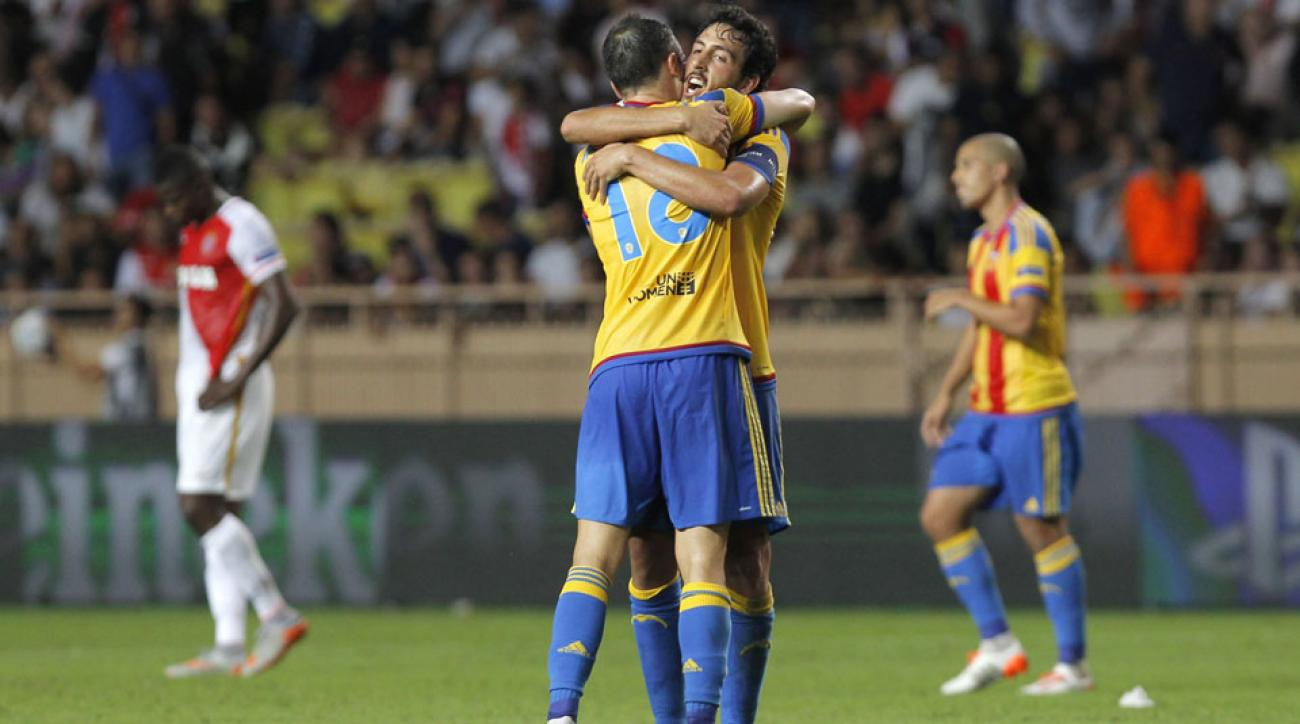 Valencia ousted Monaco to reach the Champions League group stage