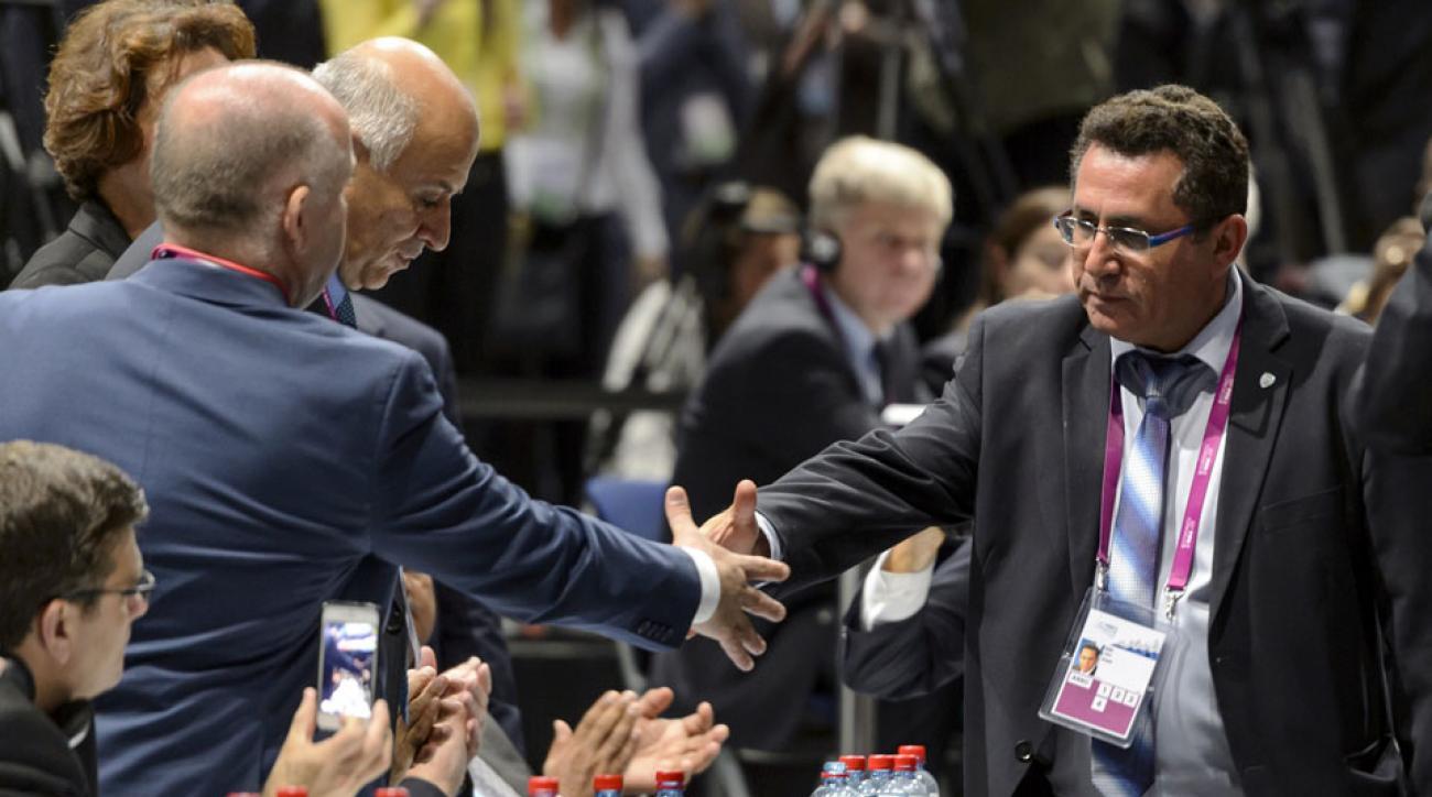 Israel, Palestine FA leaders shake hands at the FIFA Congress
