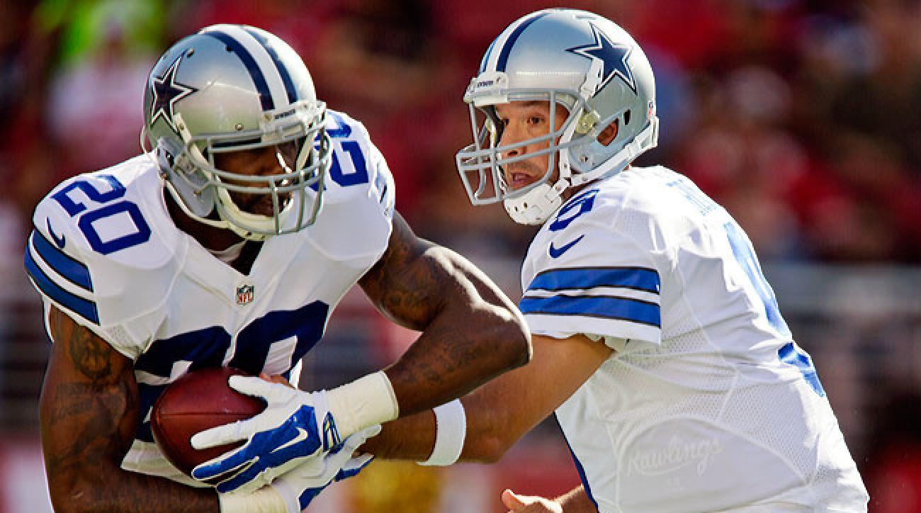 Dallas Cowboys quarterback Tony Romo hands the ball off to Darren McFadden in a recent preseason tilt. (Brian Bahr/Getty Images)