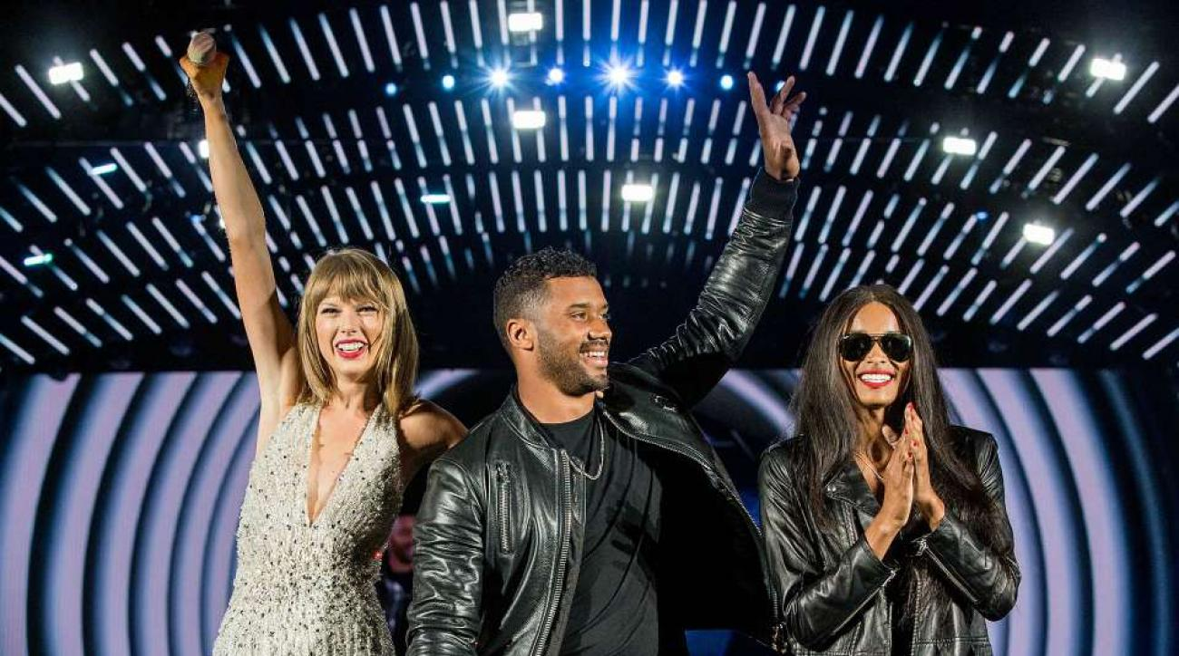 Taylor Swift Russell Wilson concert sports dancing