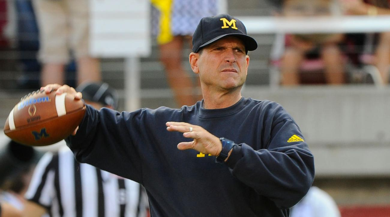 michigan football jim harbaugh warms up