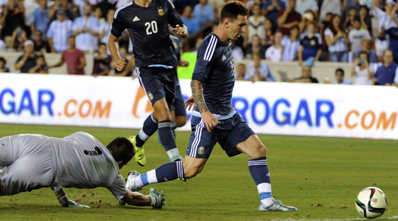 Messi rounds Daniel Vaca to score for Argentina against Bolivia in Houston