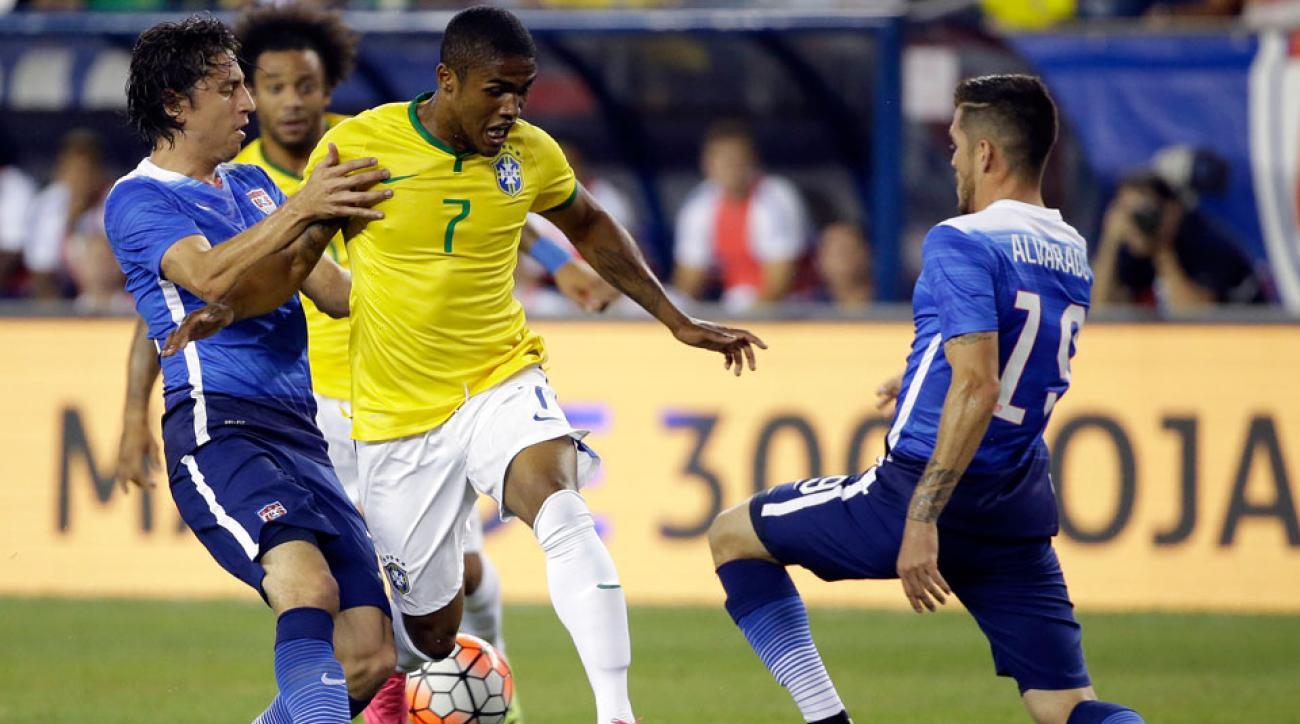 Brazil's Douglas Costa takes on U.S. defenders in their friendly