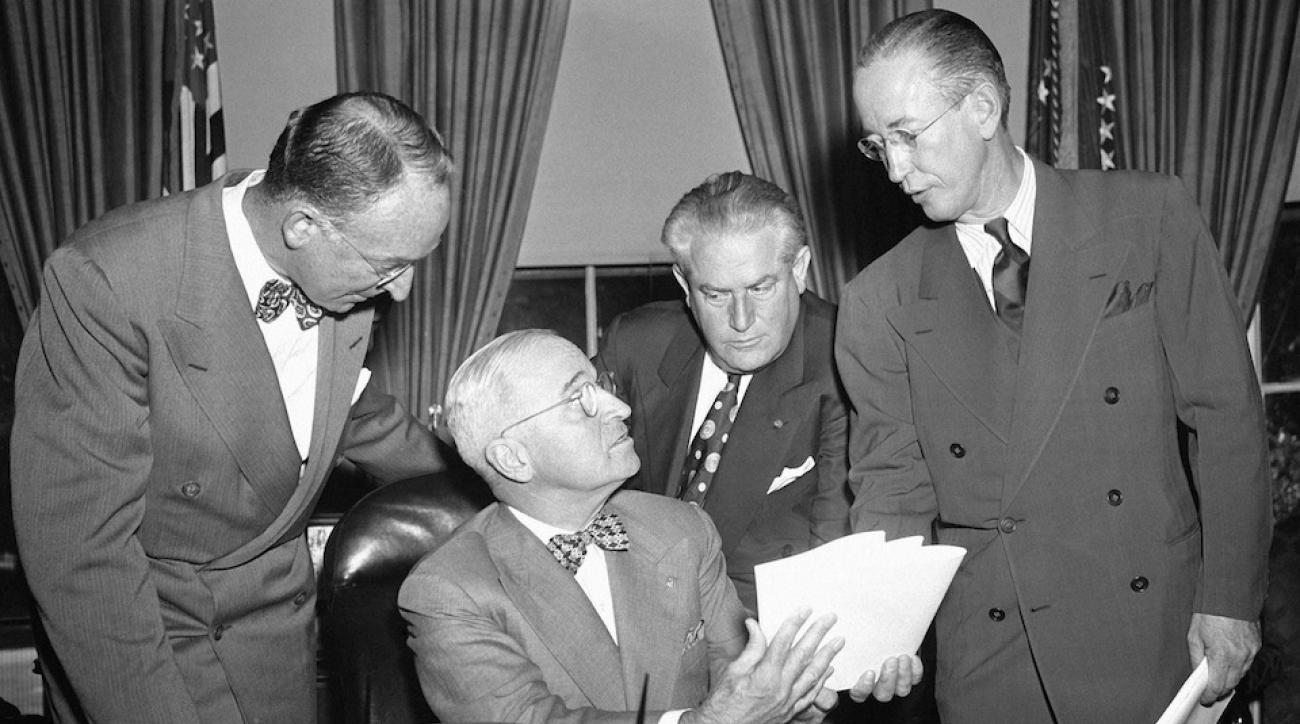 President Harry Truman meets with a three-man board responsible for settling a crucial steel dispute in 1949. This paved the way for the Steelers, we think.