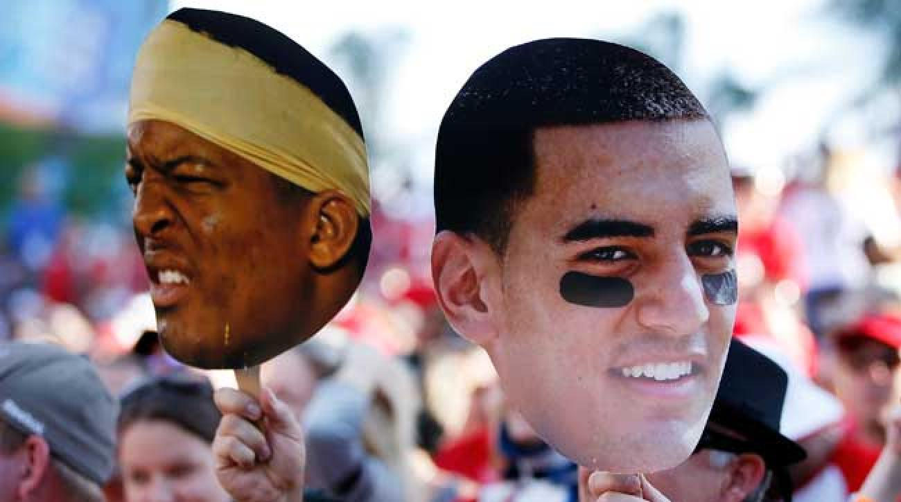 Jameis Winston and Marcus Mariota. (Joe Robbins/Getty Images)