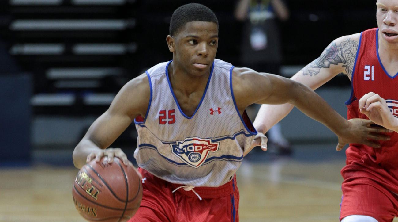 xavier simpson michigan commit recruiting basketball news