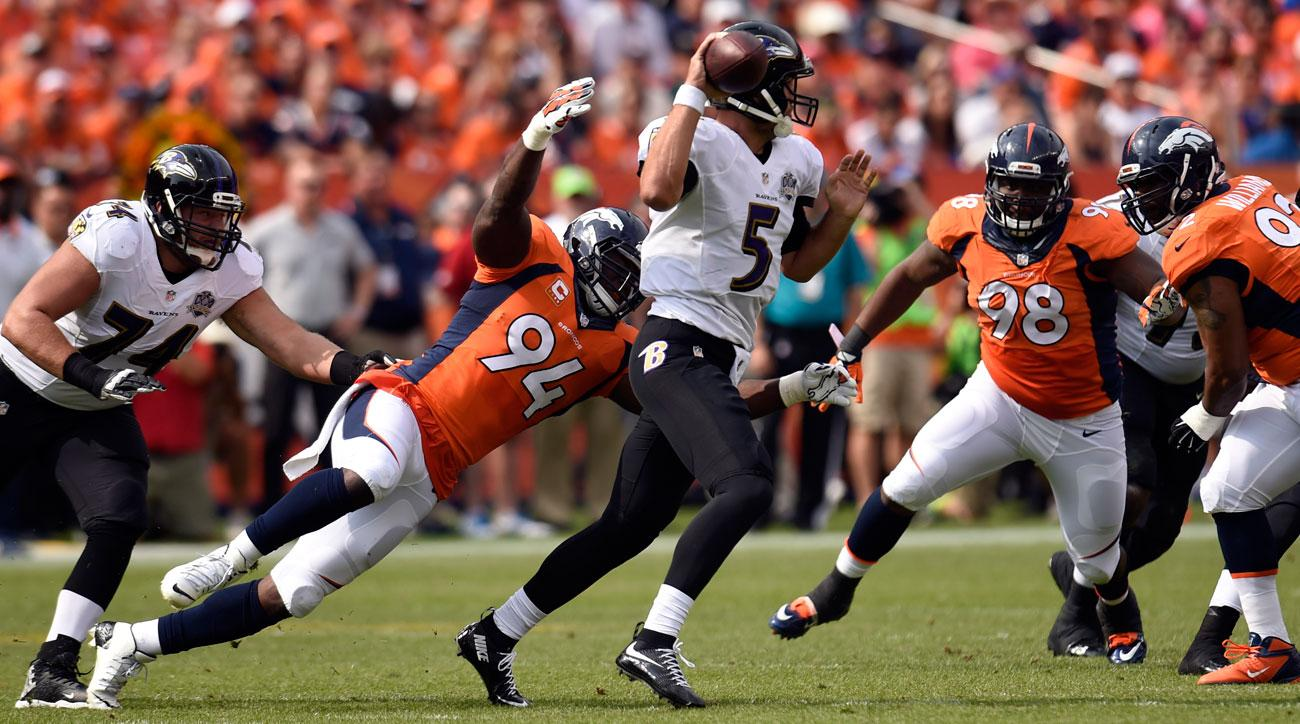 DeMarcus Ware of the Broncos bears down on Joe Flacco in Week 1.
