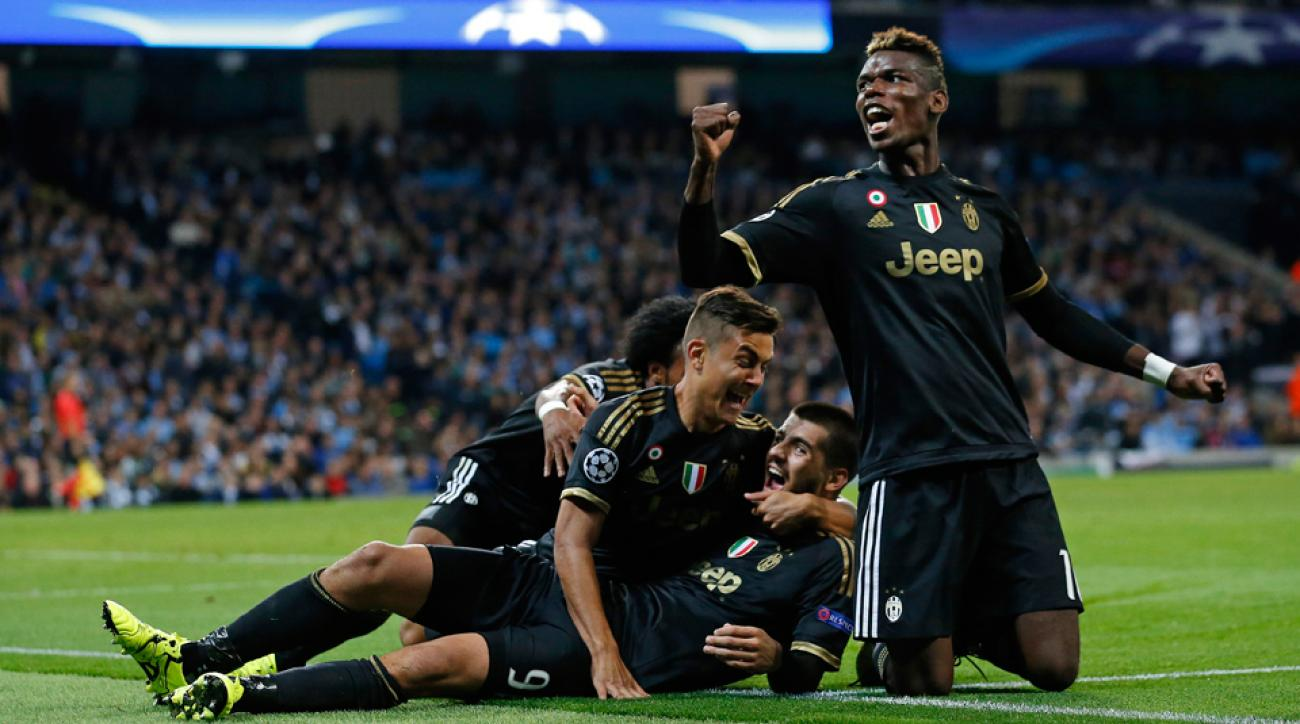 Juventus mobs Alvaro Morata after his winner against Manchester City in Champions League