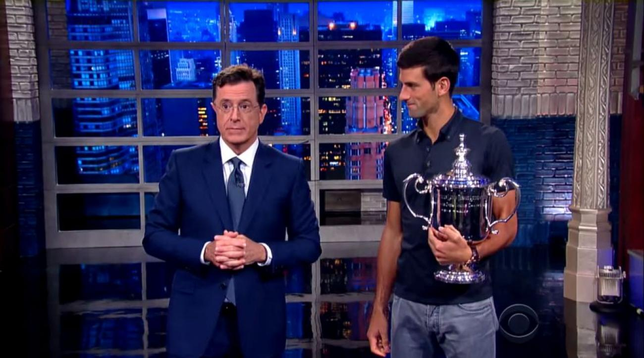 Novak Djokovic serves at Stephen Colbert