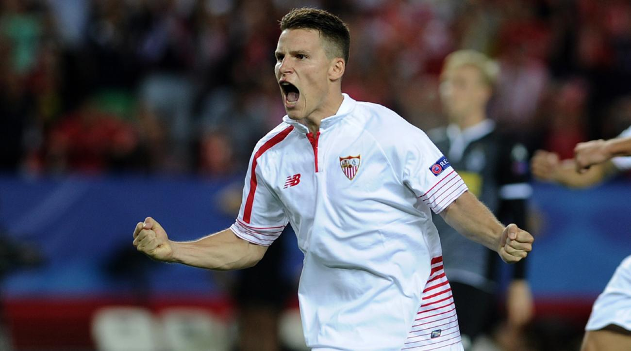 Sevilla's Kevin Gameiro scores a penalty in the Champions League