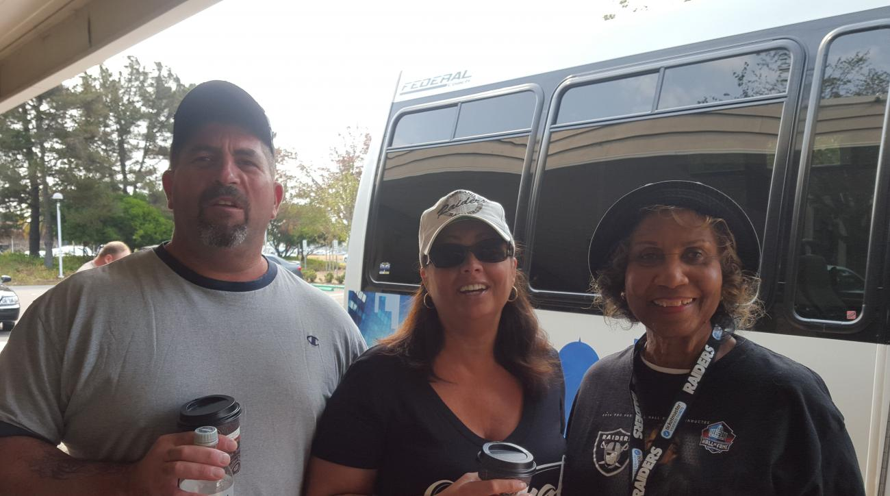 Barbara Johnson with fellow Raiders fans before boarding the bus to the Oakland Coliseum.