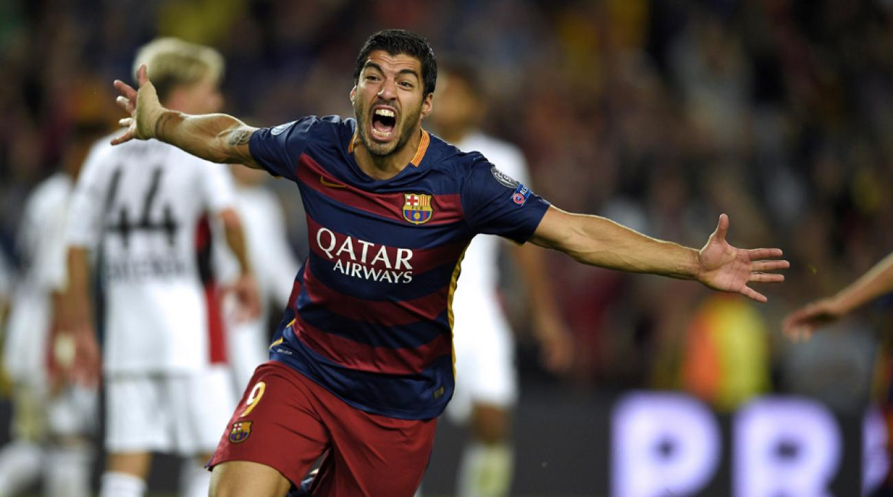 Luis Suarez scores Barcelona's winner in the Champions League