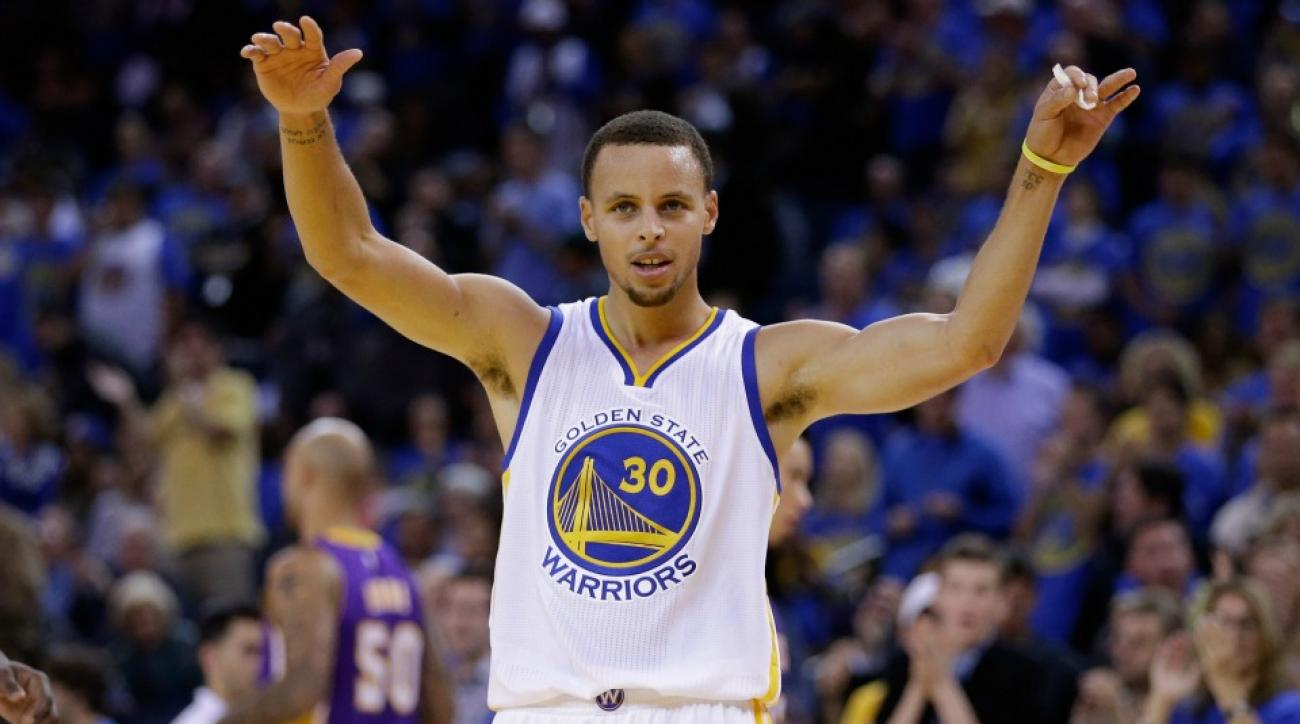 Golden State Warriors' Stephen Curry executes double dunk