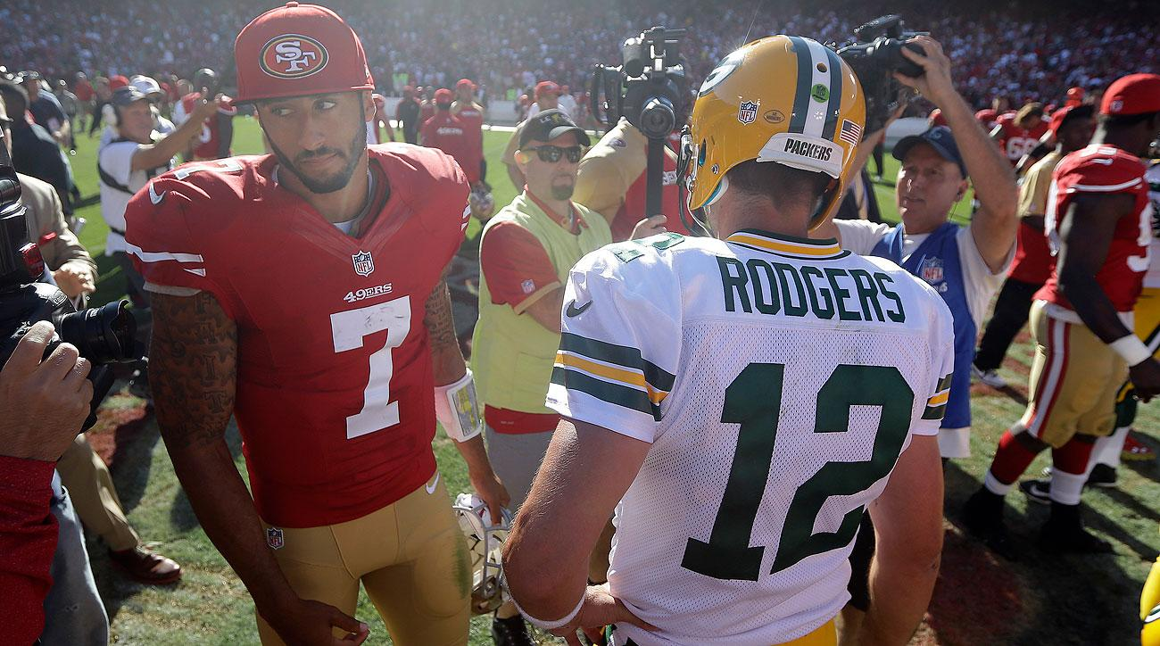 Colin Kaepernick and Aaron Rodgers are coming off vastly different weeks. (Marcio Jose Sanchez/AP)