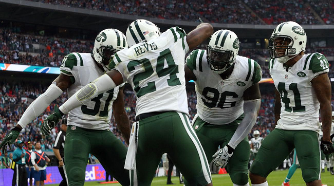 Jets CBs Darrelle Revis, Antonio Cromartie and Buster Skrine celebrate interception against Dolphins in London.