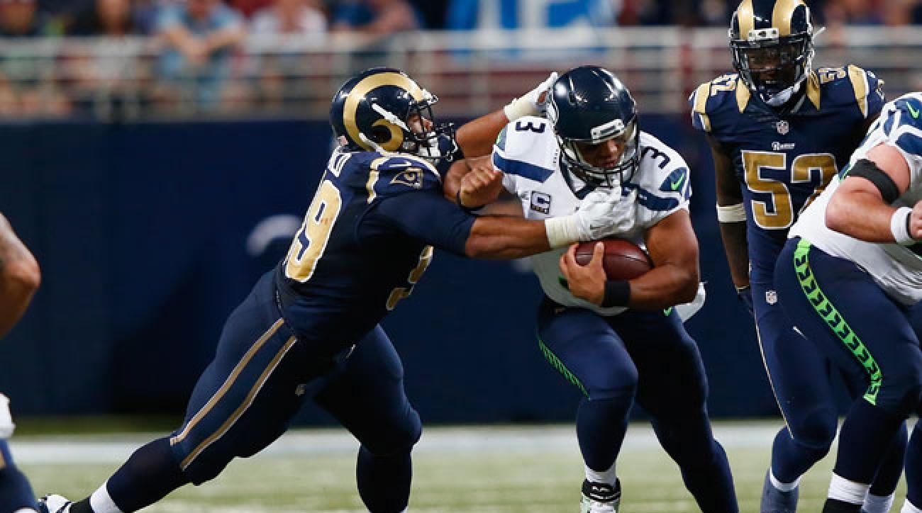 St. Louis Rams defensive tackle Aaron Donald sacks Seattle Seahawks quarterback Russell Wilson. (Jamie Squire/Getty Images)