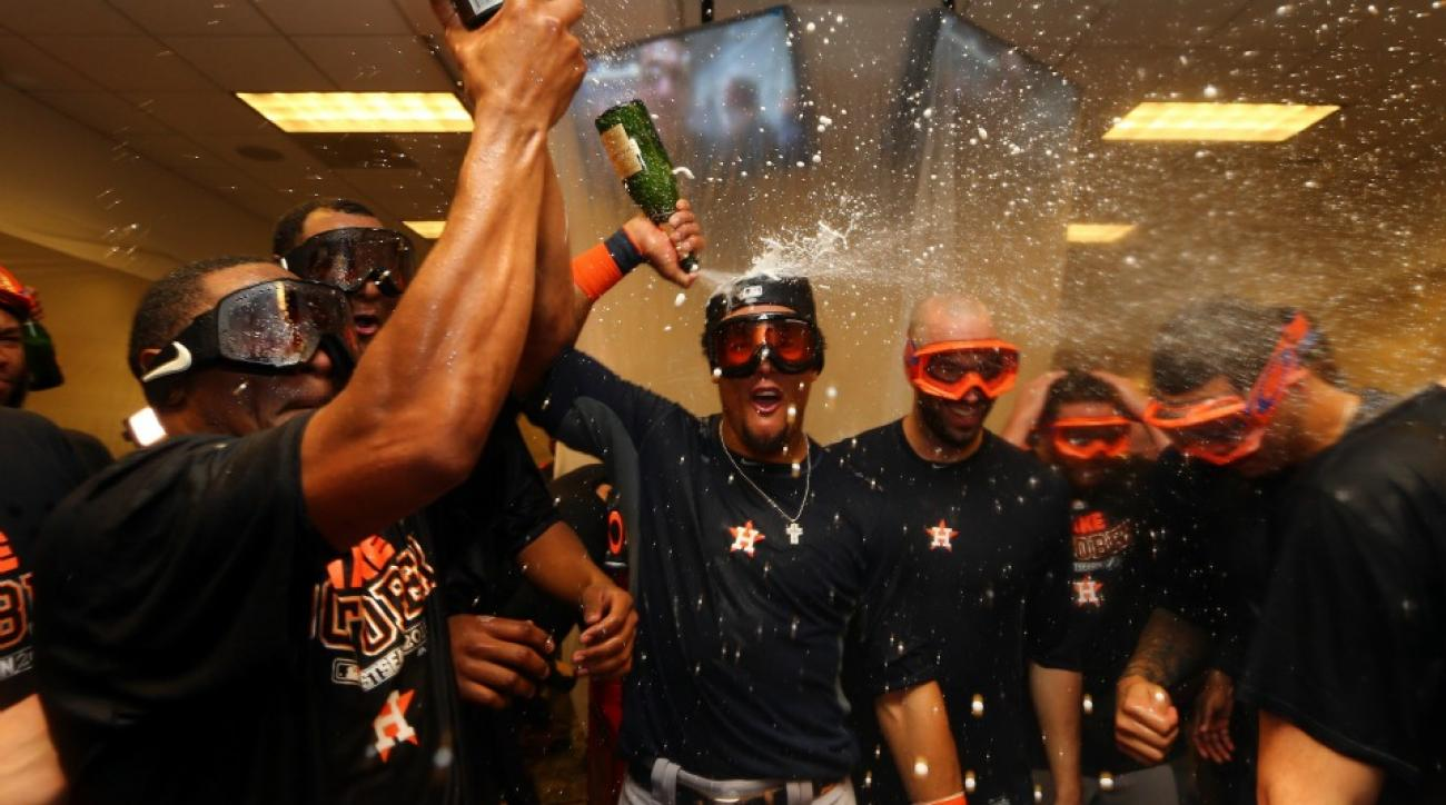 Houston Astros' Carlos Correa covers Buster Olney in Champagne