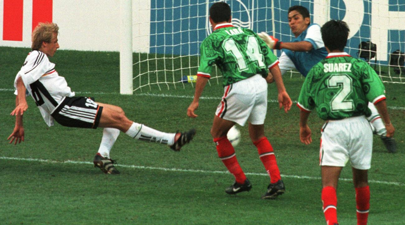 Jurgen Klinsmann scores against Mexico for Germany in the 1998 World Cup