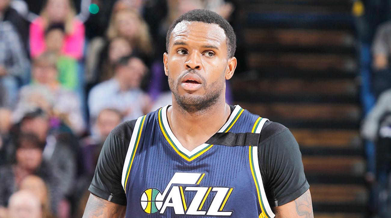 Jazz's Trevor Booker was ejected for hitting the Lakers' Roy Hibbert.