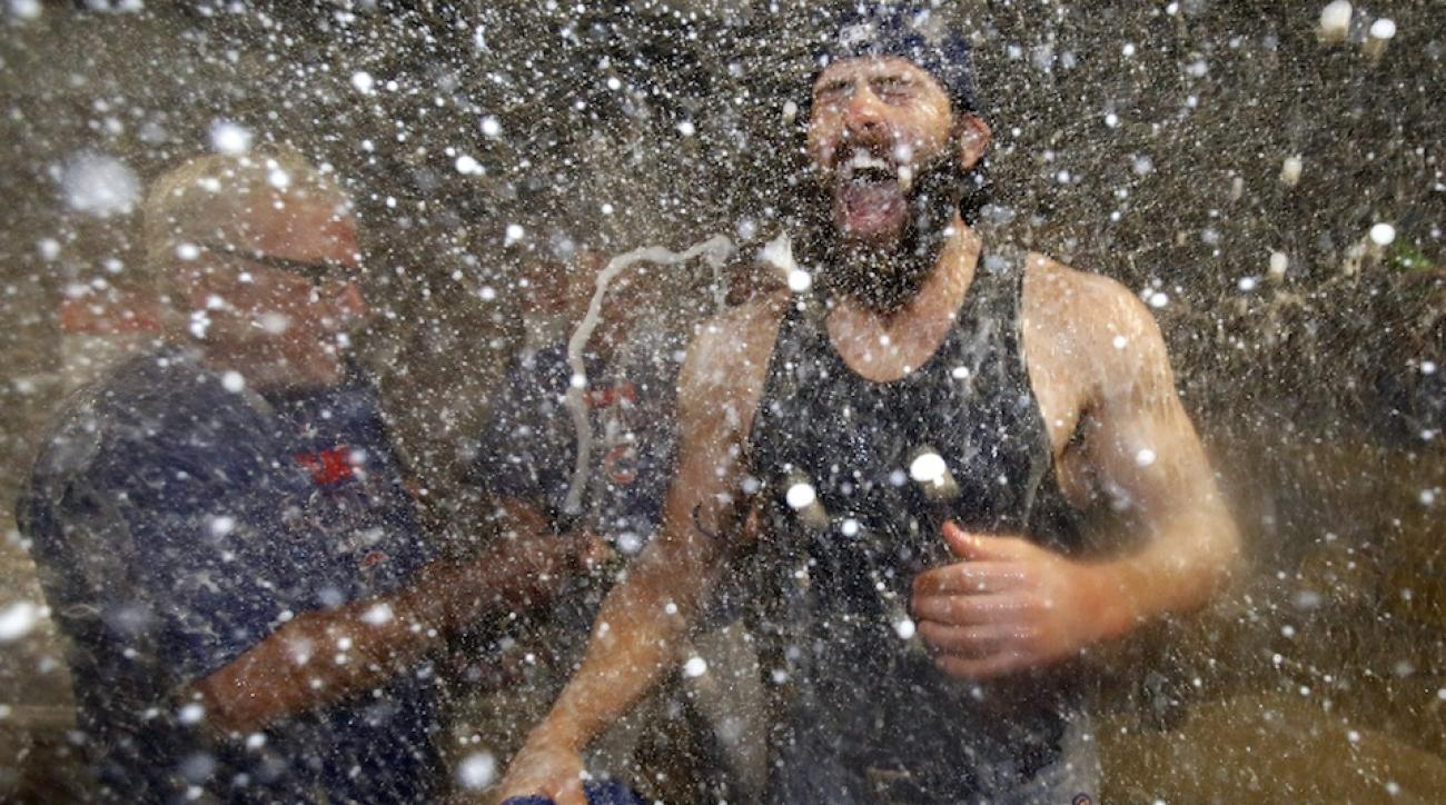 A champagne-soaked Joe Maddon (l) and Jake Arrieta (r) celebrate the Chicago Cubs' wild card win over the Pittsburgh Pirates.