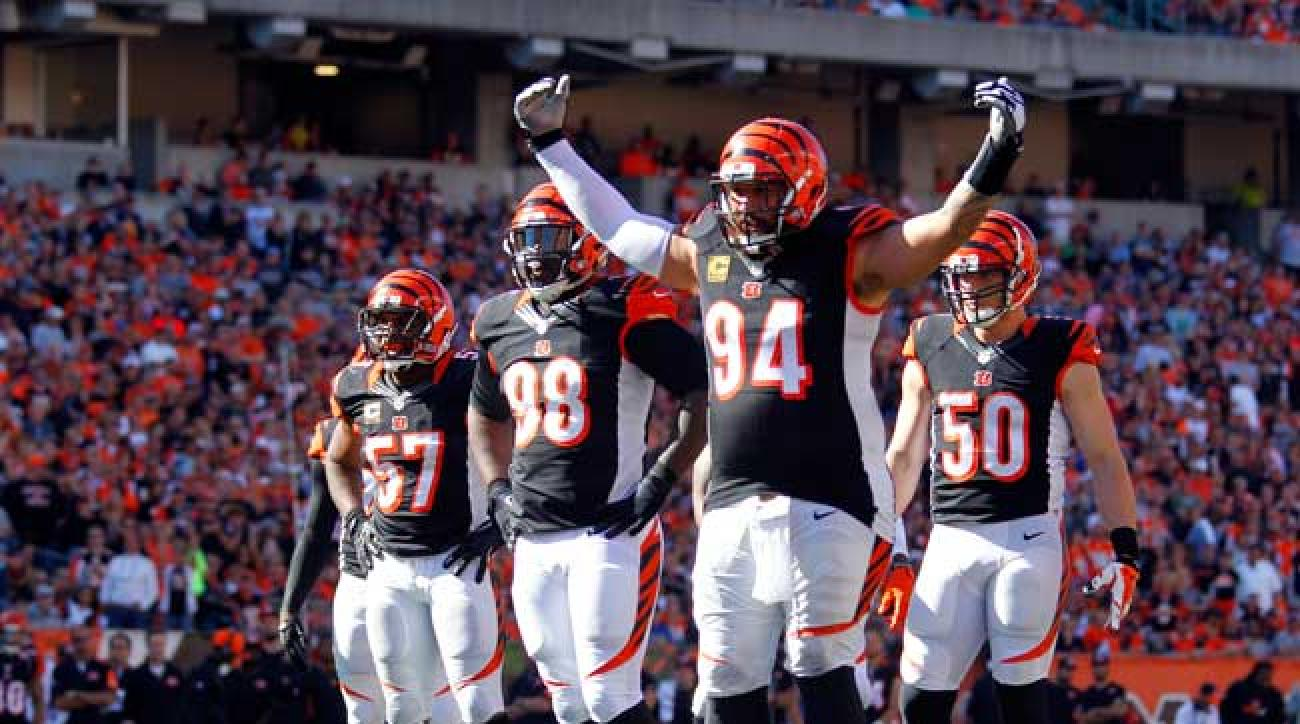 Bengals defenders Domata Peko (94), Brandon Thompson (98), Vincent Rey (57) and A.J. Hawk (50) wait for the Seahawks offense at Paul Brown Stadium on Sunday.