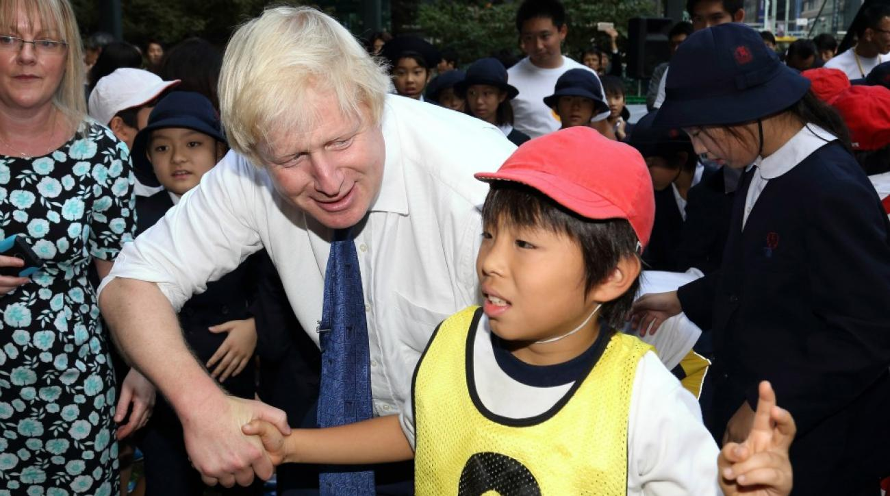 London Mayor Boris Johnson knocks over small child playing rugby