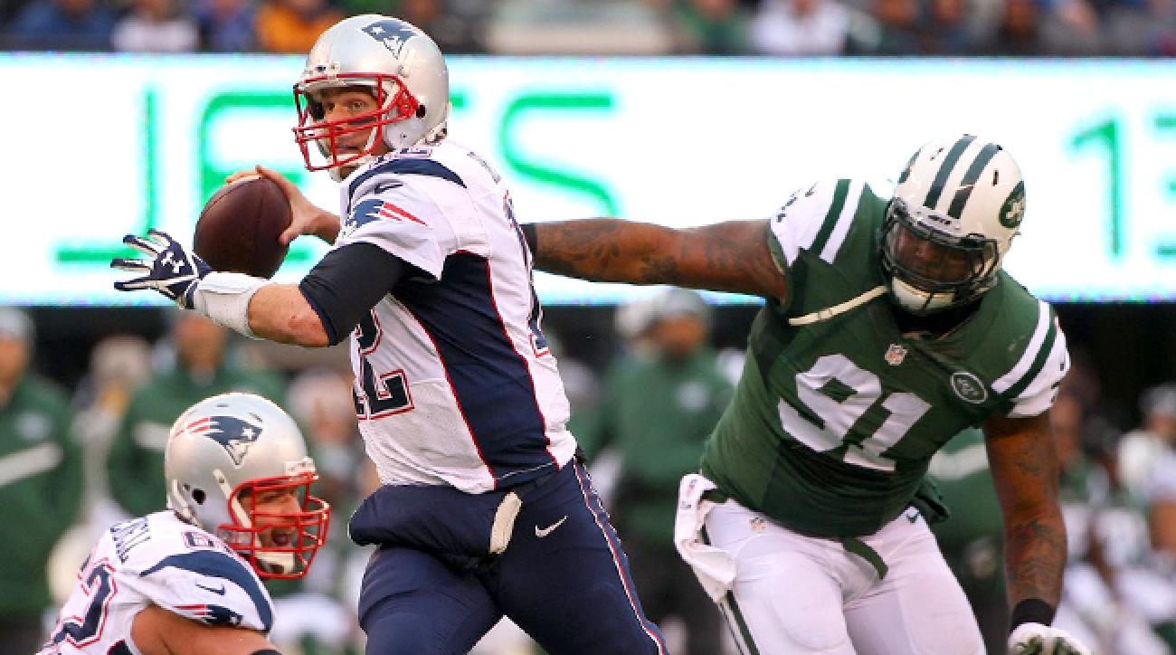 Tom Brady of the Patriots and Sheldon Richardson of the Jets in a 2014 game.