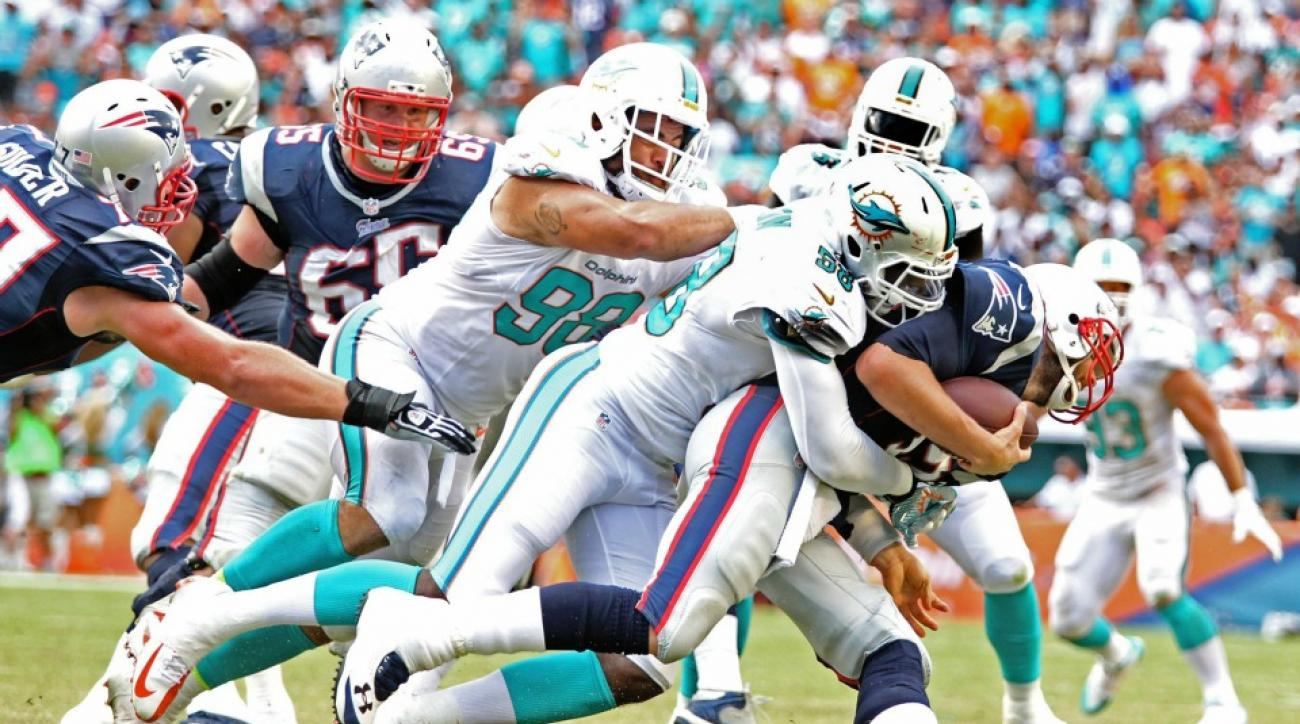 New England Patriots Tom Brady gets head Crushed in Dolphins LB's twitter avatar