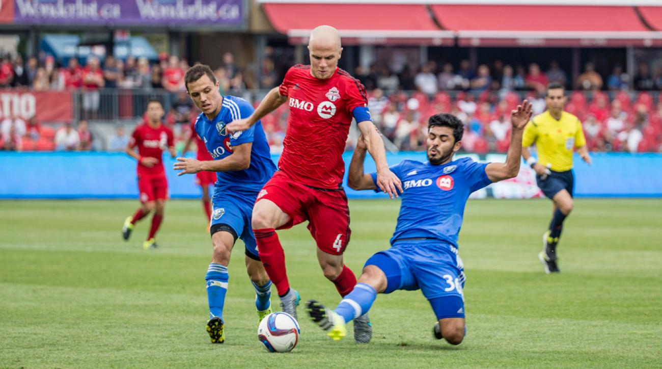 Toronto FC's Michael Bradley takes on the Montreal Impact