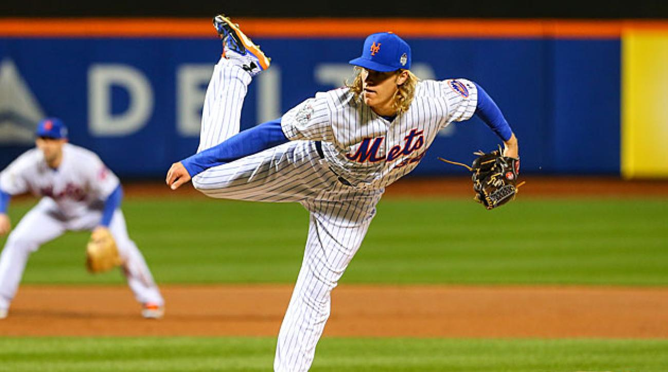 Noah Syndergaard used a new pitch and David Wright (background) looked like his old self during New York's 9-3 win on Friday.