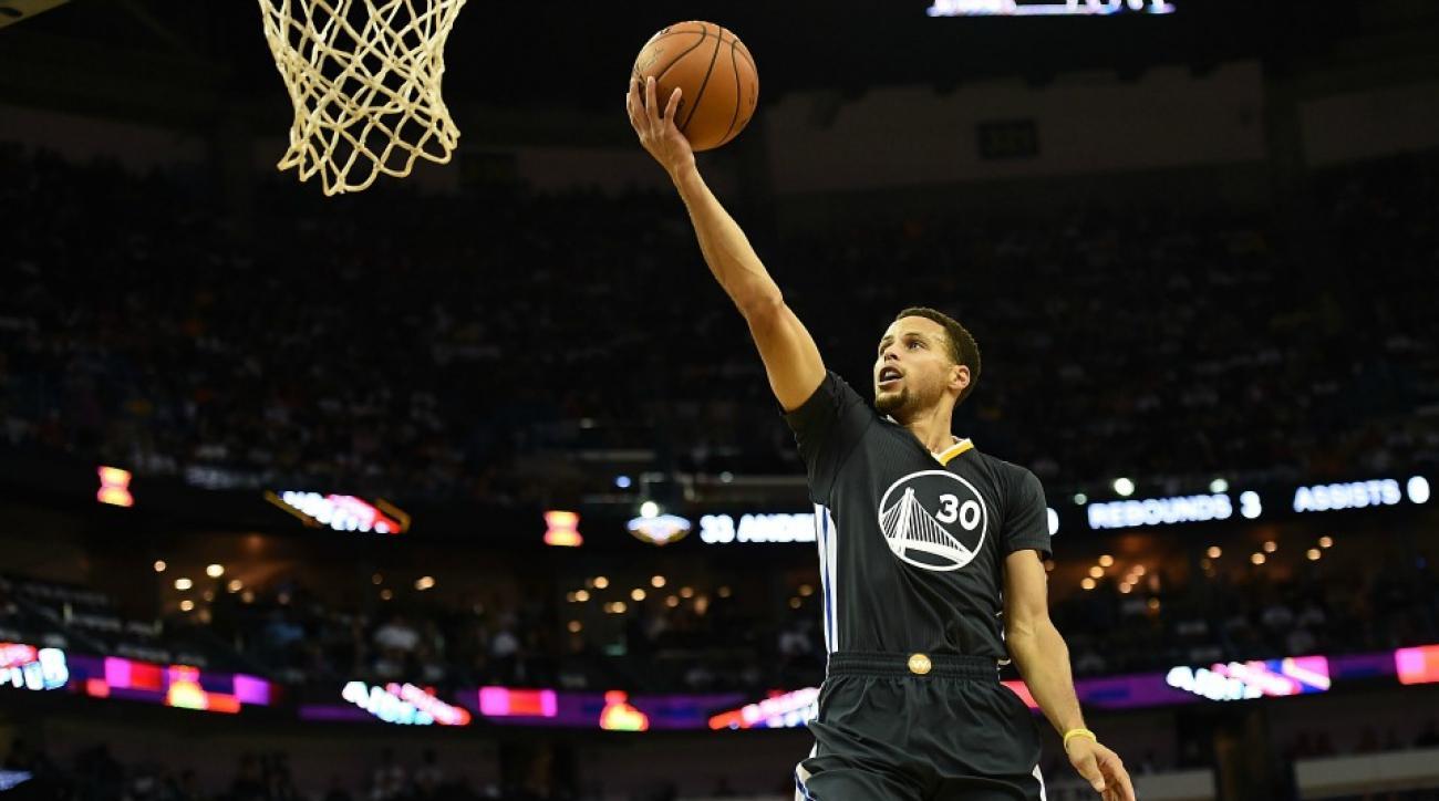 Golden State Warriors' Stephen Curry wears a zebra head at mall