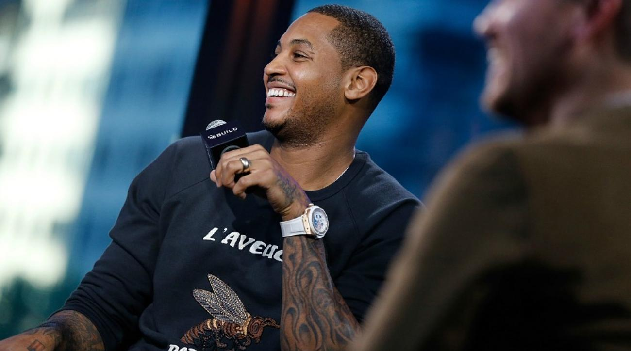 New York Knicks' Carmelo Anthony shows off his watch collection