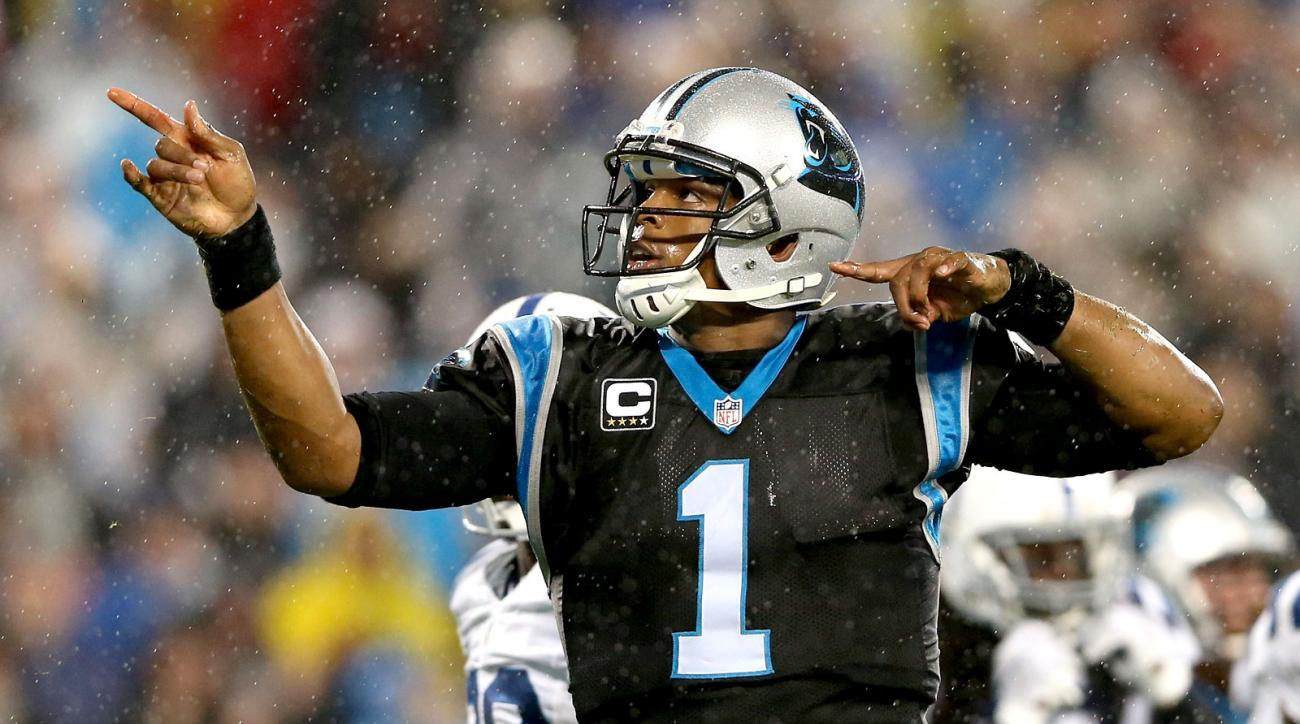 709166c05 Cam Newton of the Panthers signals first down against the Colts in Week 8  in 2015