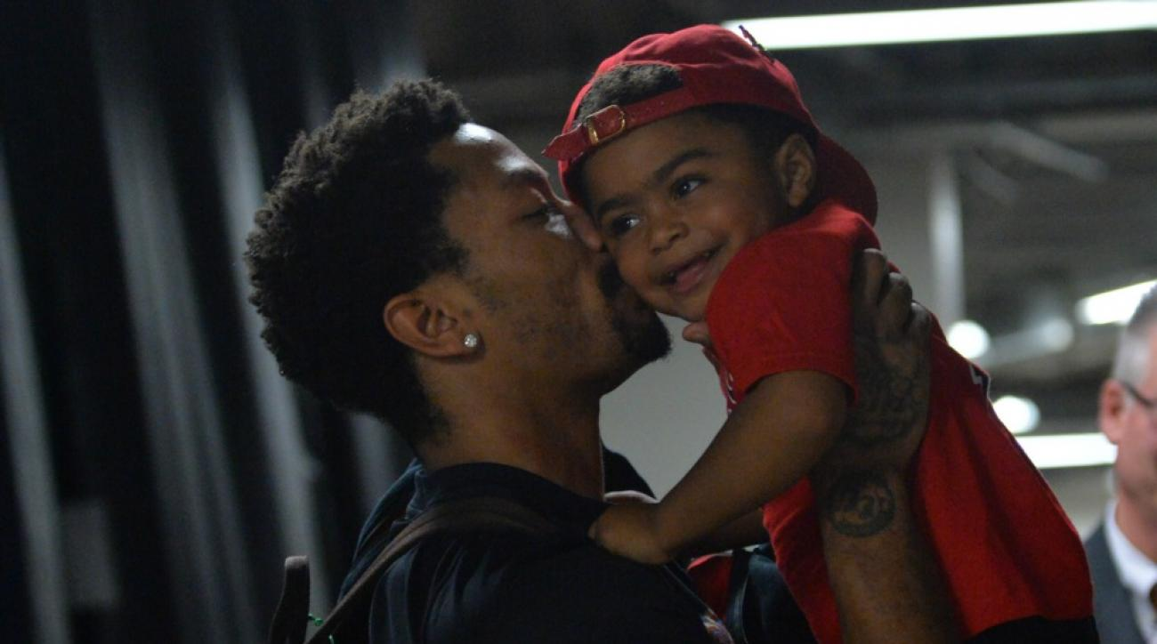 Chicago Bulls' Derrick Rose wore a shirt with his son's face on it