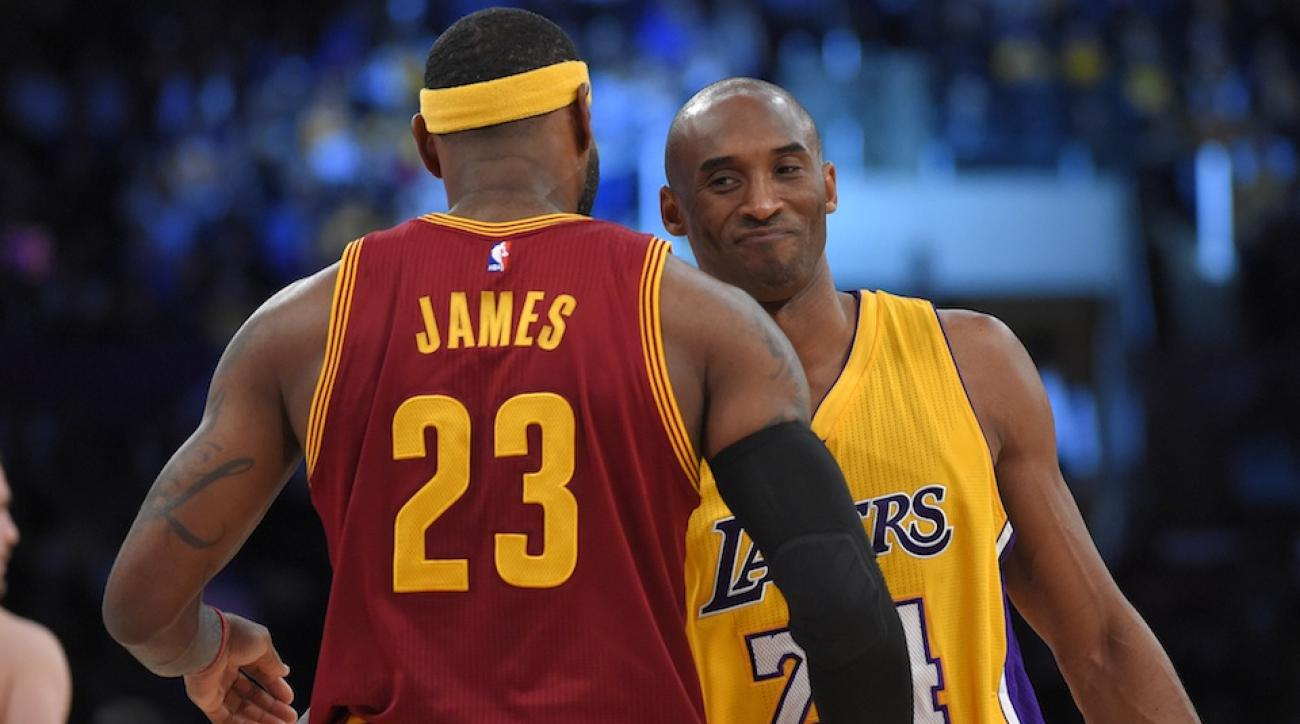 LeBron James and Kobe Bryant embrace before a 2015 regular-season game.