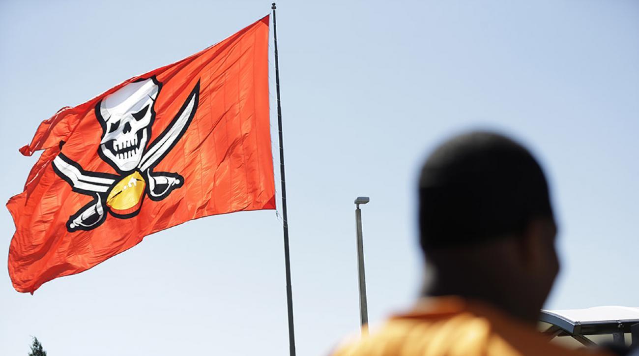 giants buccaneers fan arrest burn flag