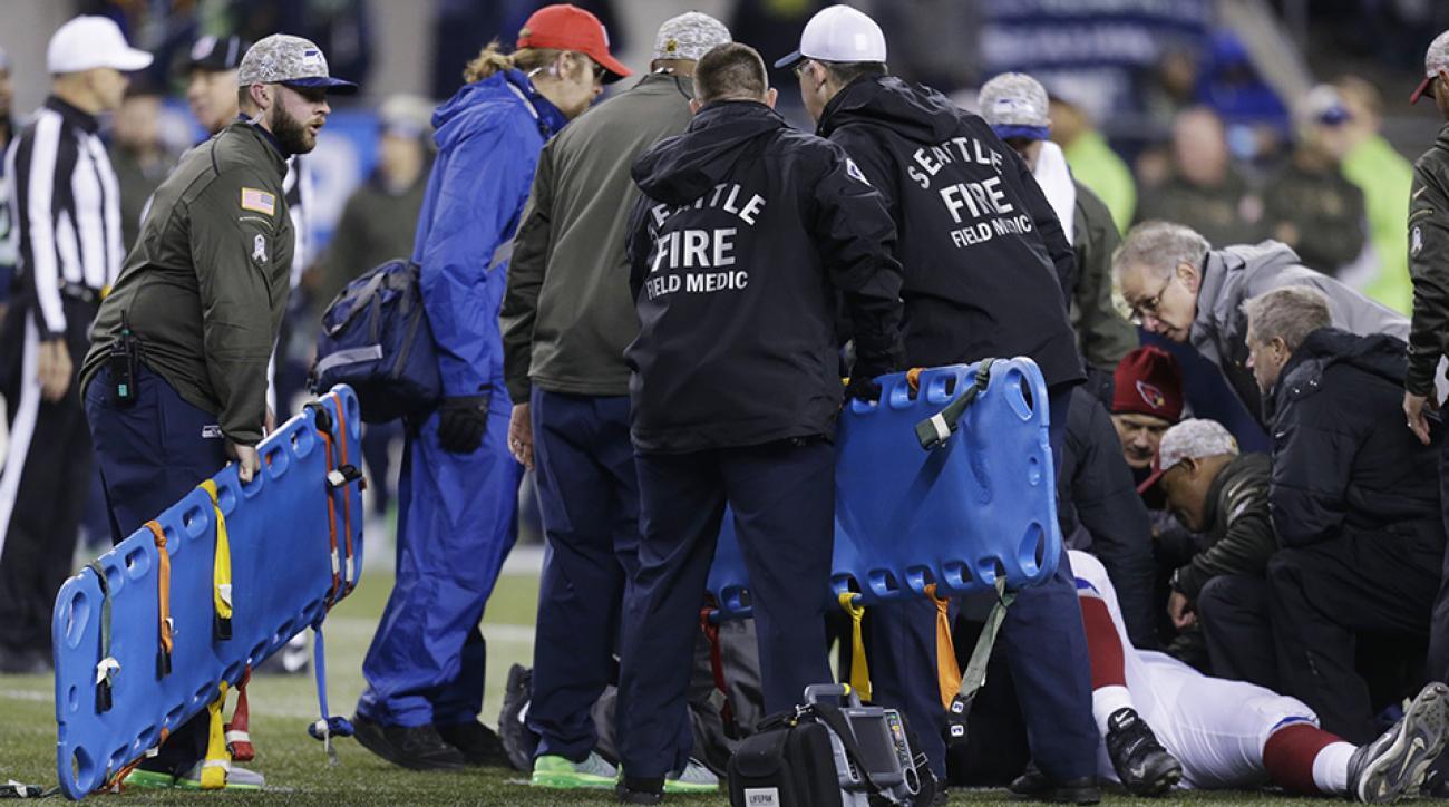 mike iupati injury update cardinals seahawks ambulance