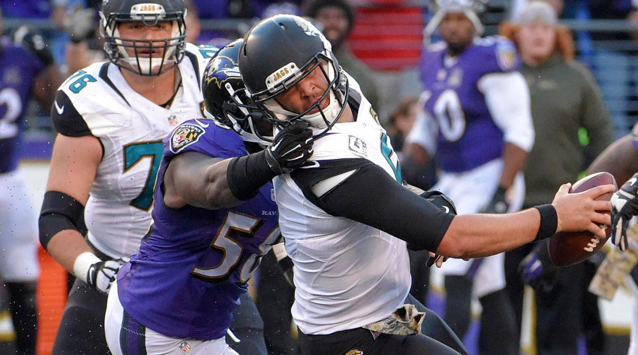 Elvis Dumervil pulls down Blake Bortles by the face mask in the Ravens-Jaguars game in Week 10 in 2015.
