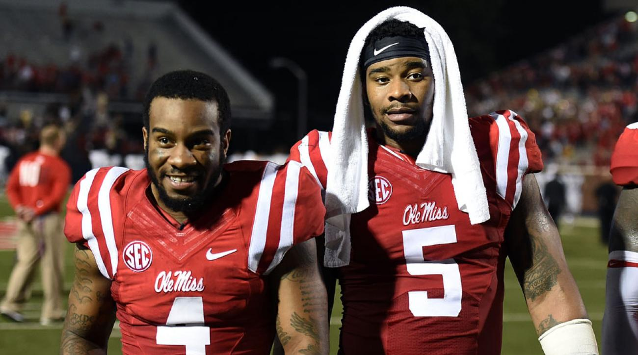 Denzel Nkemdiche (left) stands with his brother Robert Nkemdiche, who also plays for Mississippi, after a win over Vanderbilt on Sept. 26, 2015.